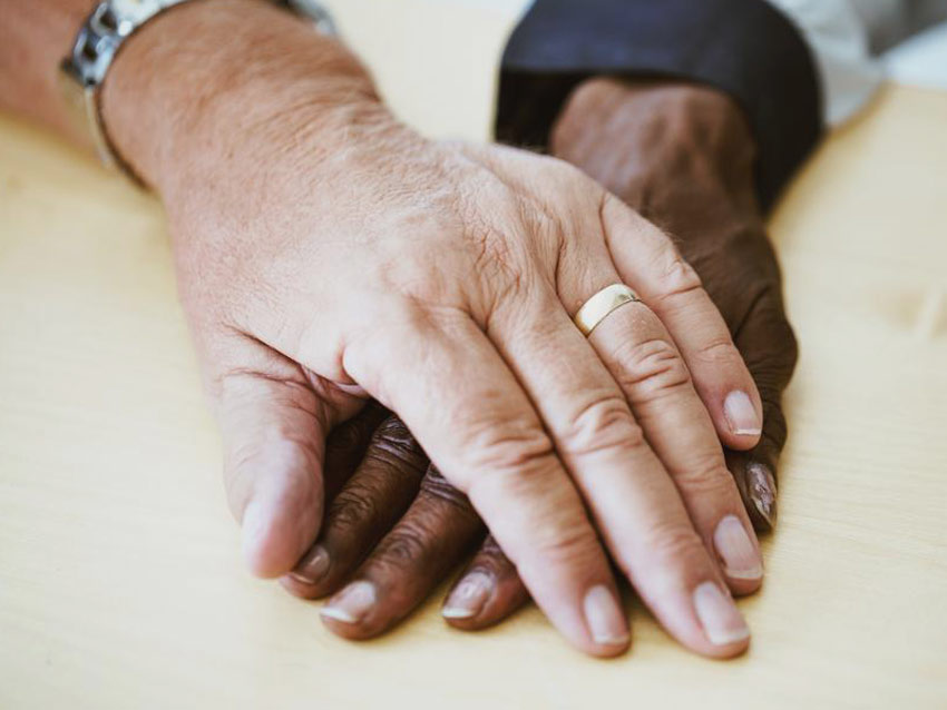 Hands of an older couple, keeping their love alive